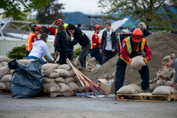 flood preparation in the okanagan - natural disaster stock pictures, royalty-free photos & images