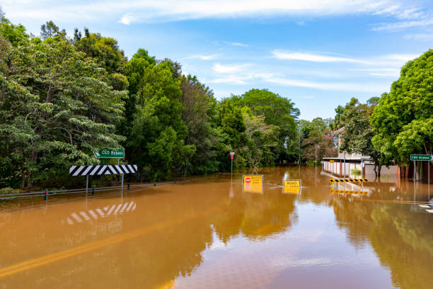Flood Sign Under Water in the Lismore CBD stock photo