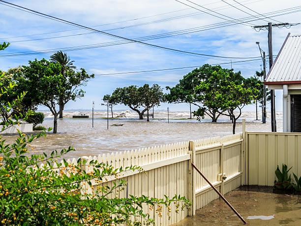 Flood waters across a suburban street stock photo