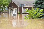 Flood waters in an Indiana town with flooded homes