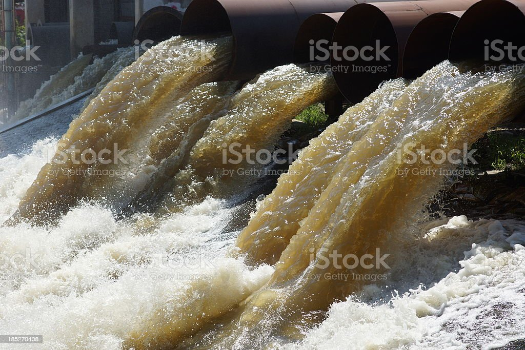 Flood wave from sewer pipe in Bangkok, Thailand stock photo