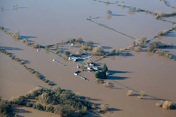 """Flooded aerial views of Gloucestershire in UK """"An aerial view from a light aircraft of an English pub and sailing club, surrounded by water when the River Severn burst it's banks in November 2012. Sharp focus is on the pub Adobe RGB 1998 profile."""" sailing dinghy stock pictures, royalty-free photos & images"""