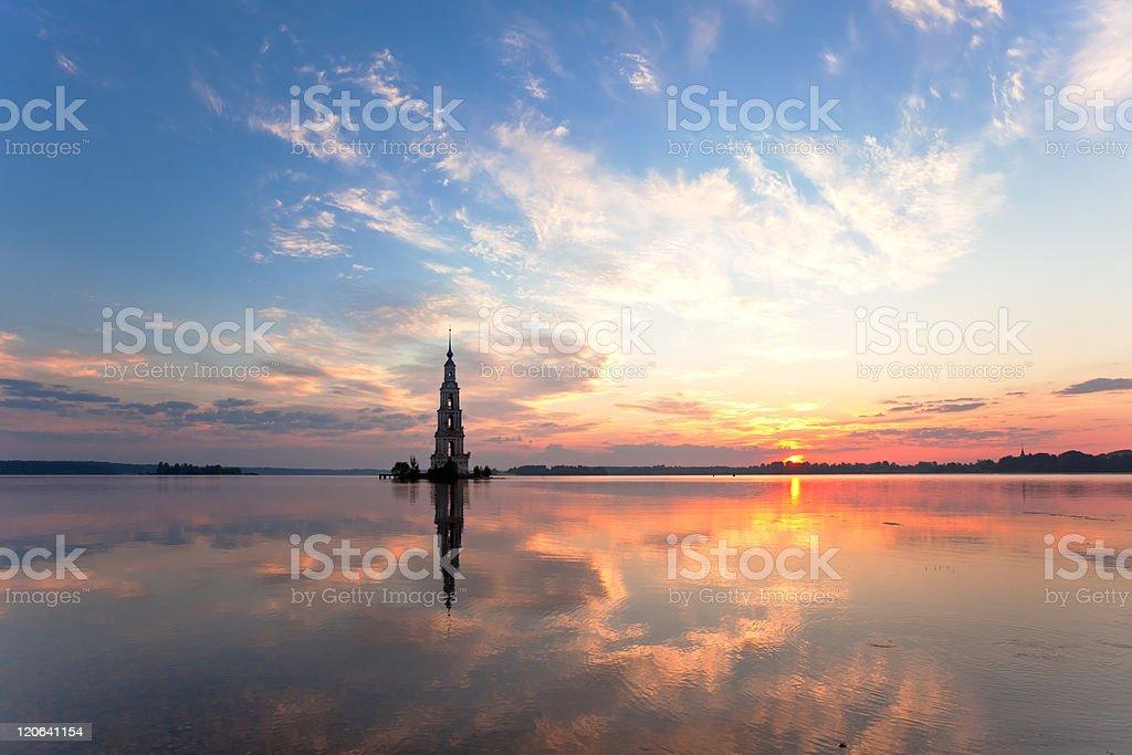 flooded belltower in Kalyazin at sunrise stock photo