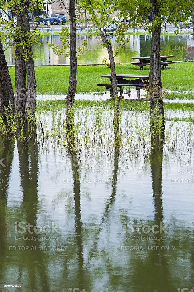 Flooded bicycle path and picnic area. royalty-free stock photo