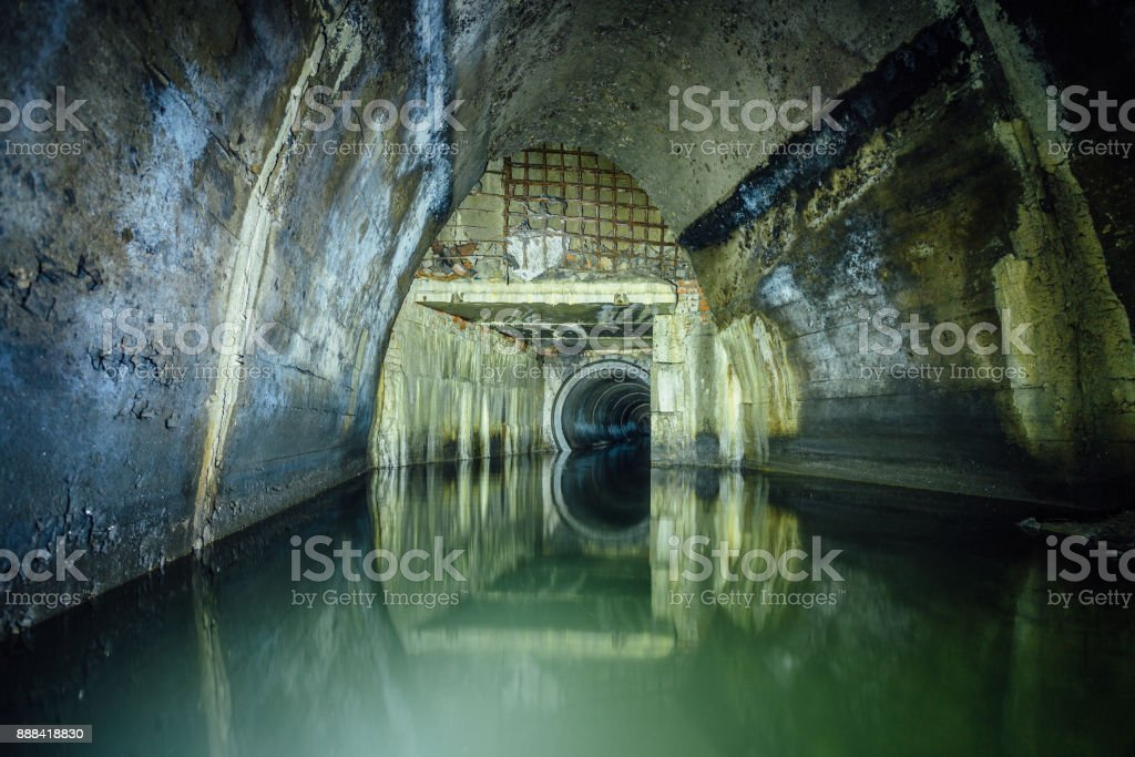 Flooded by dirty industrial wastewater sewage collector. Sewer tunnel under city stock photo