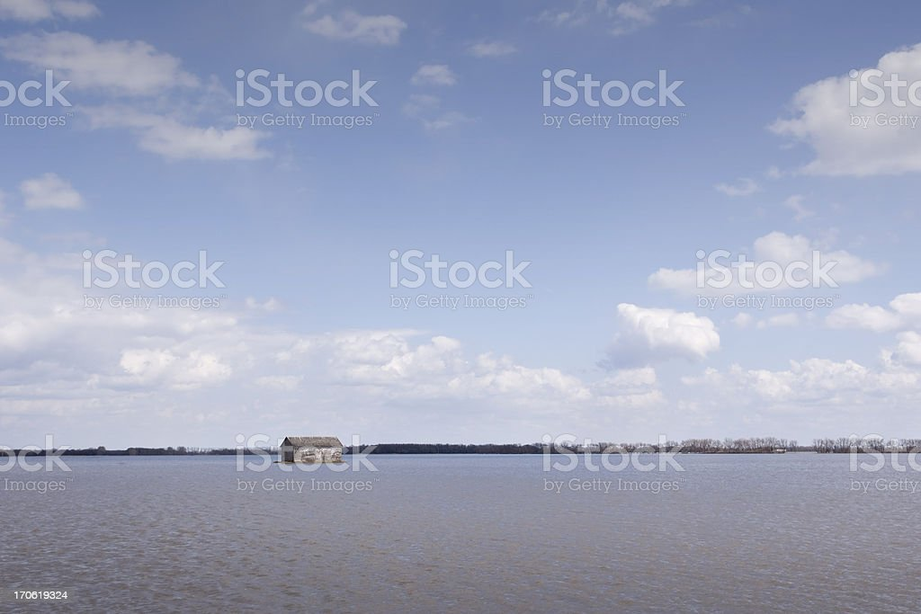 flooded field with old building royalty-free stock photo