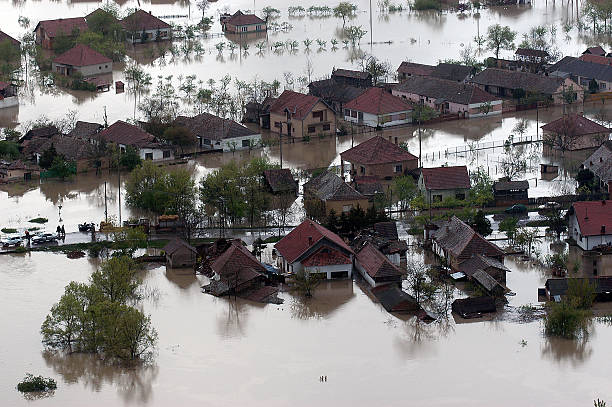 flooded house aerial view - extreme weather stock pictures, royalty-free photos & images