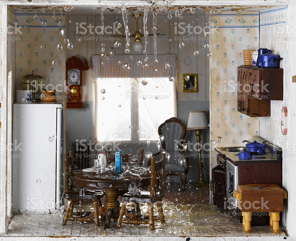 Flooded house and ceiling leaking water into kitchen royalty-free stock photo