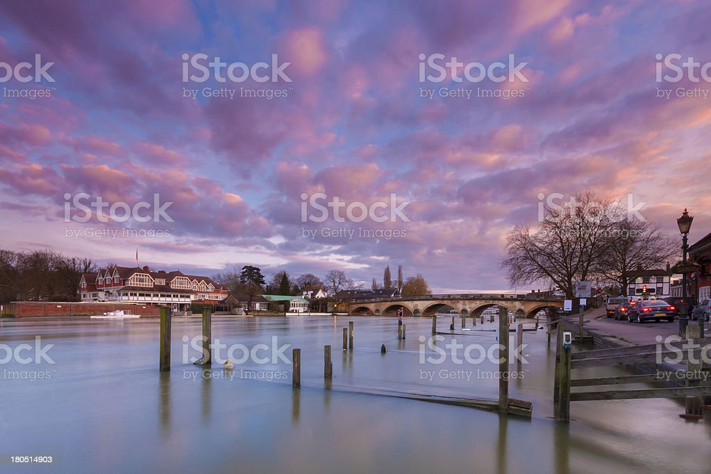 Flooded jetties and arched Henley bridge over the river Thames stock photo