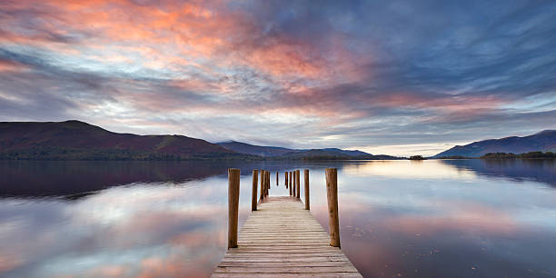 Flooded jetty in Derwent Water, Lake District, England at sunset stock photo