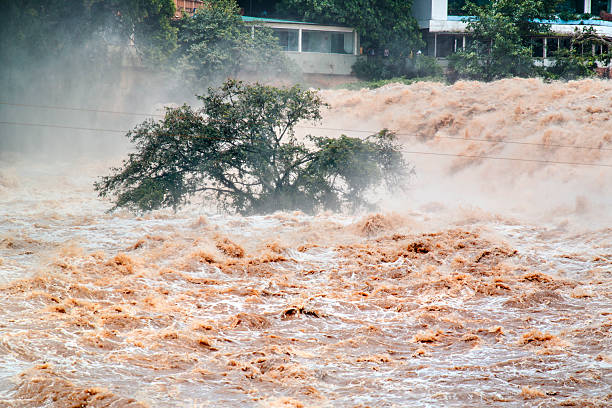 flooded of muddy water. overflow. - extreme weather stock pictures, royalty-free photos & images