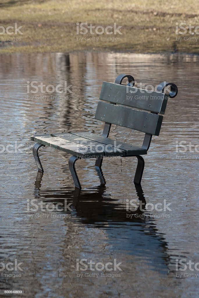Flooded park bench stock photo