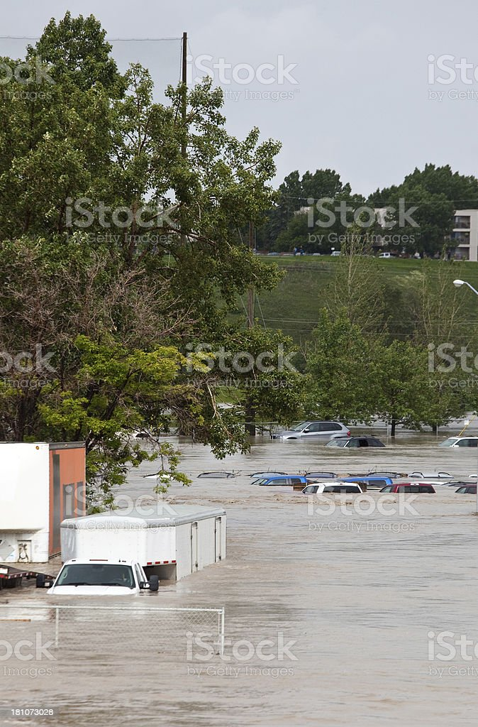 Flooded Parking Lot and Damaged Vehicles After Flash Flood royalty-free stock photo