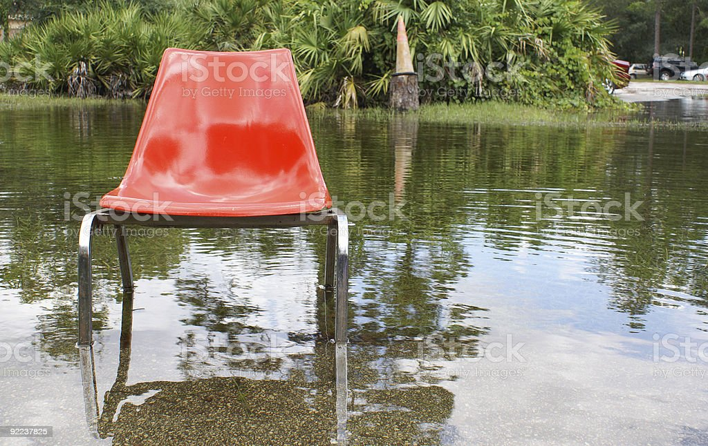 Flooded Parking Lot With Chair royalty-free stock photo