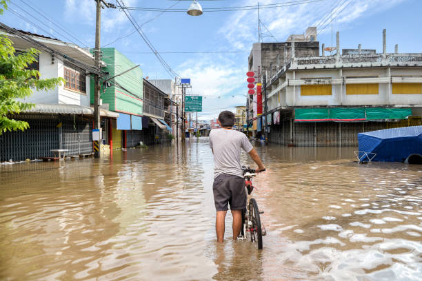flooded road during a flood caused by heavy rain - natural disaster stock pictures, royalty-free photos & images