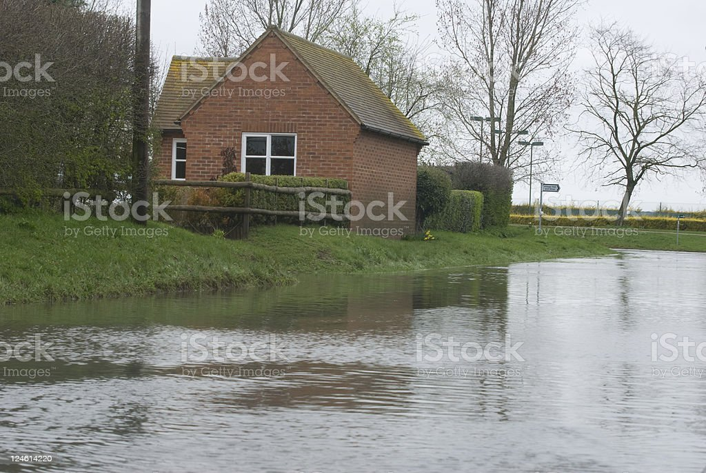 Flooded road in rural village royalty-free stock photo