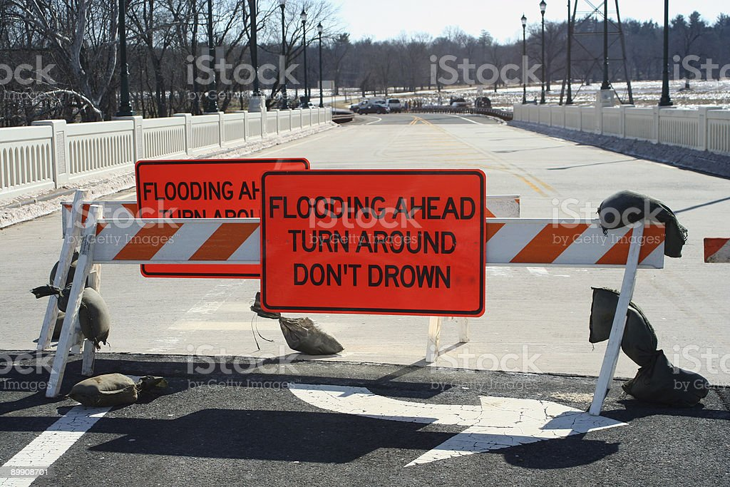 Flooded roadway sign on a bridge royalty-free stock photo