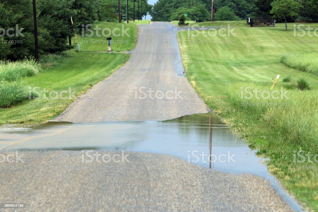 Flooded rural road - Royalty-free Accidents and Disasters Stock Photo