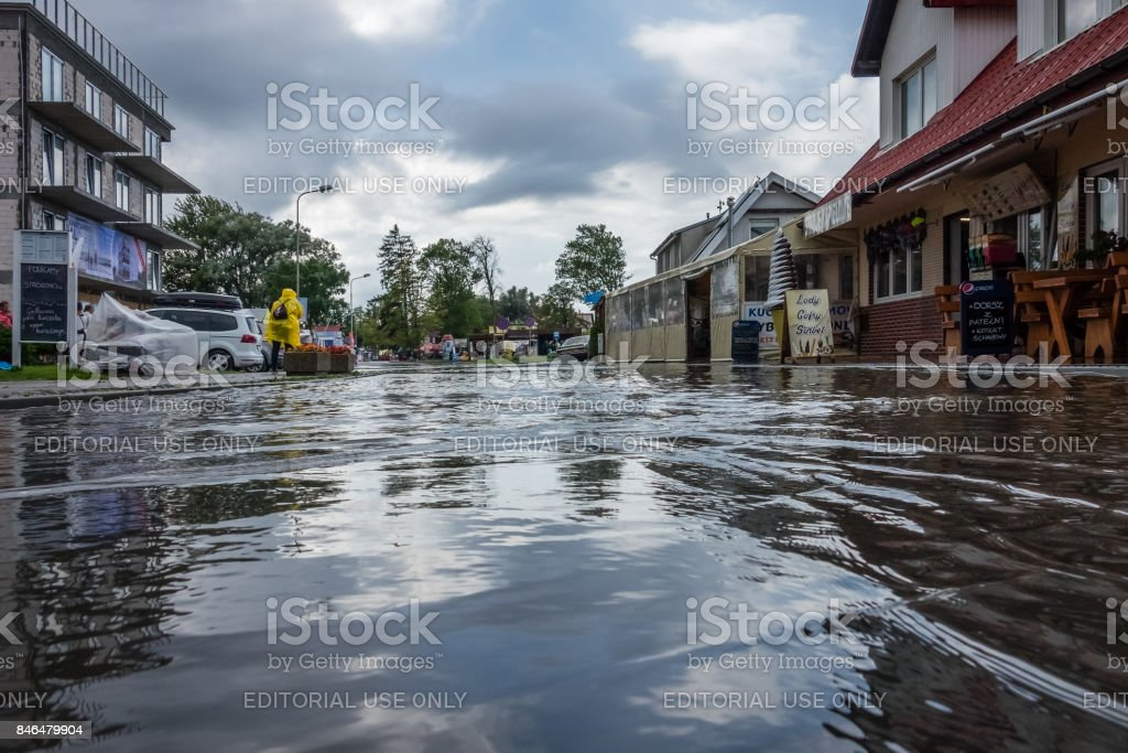 Flooded street after torrential rain stock photo