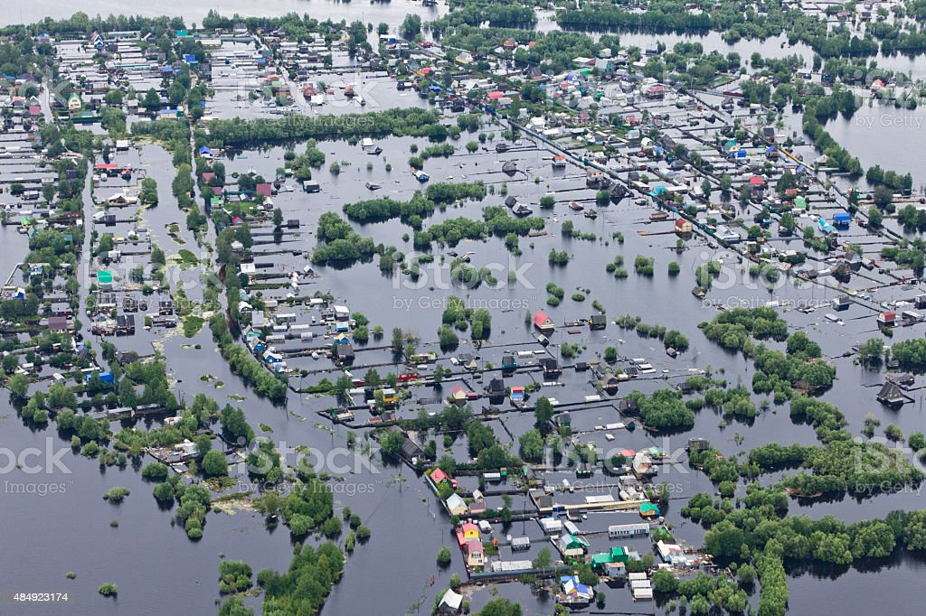 Flooded village in lowland of Great river stock photo