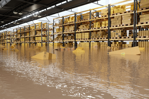 Flooded Warehouse With Cardboard Boxes Floating On Water