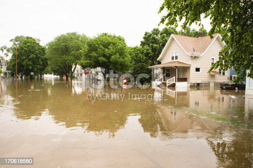 Water floods neighborhood in the Midwest..If you like this image you may want to look at other IOWA Images of mine :