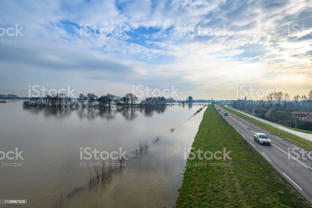 Flooding in the overflow area against the dyke of the river IJssel near Zwolle in The Netherlands stock photo