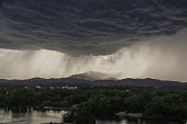 Flooding water out of heavy rain clouds in the Californian region