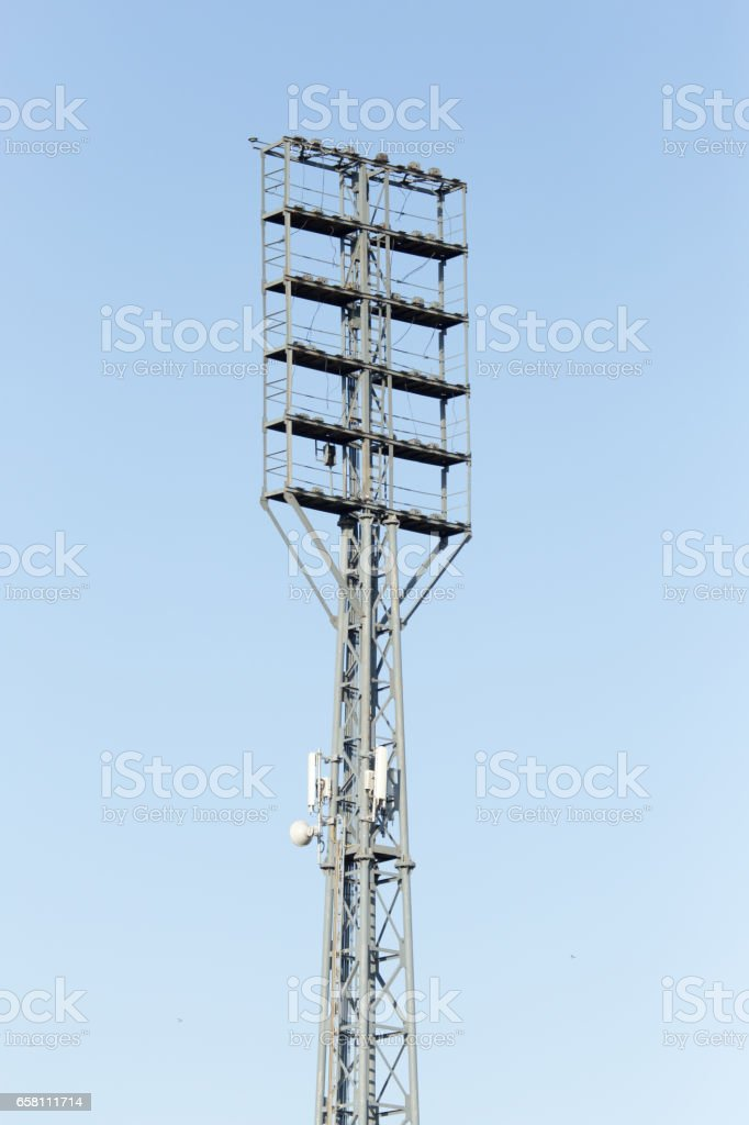 Floodlight at the stadium against the blue sky royalty-free stock photo