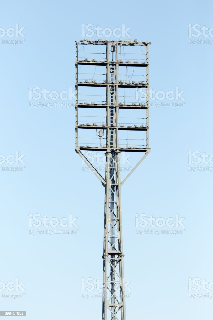 Floodlight at the stadium against the blue sky stock photo