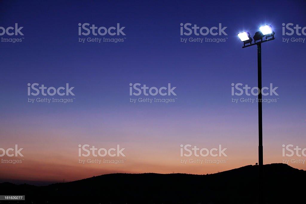 Floodlights at sundown royalty-free stock photo