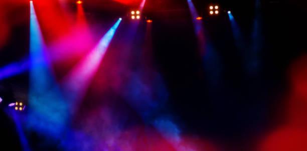 washers scen under en rockkonsert. suddig bakgrund. - disco lights bildbanksfoton och bilder