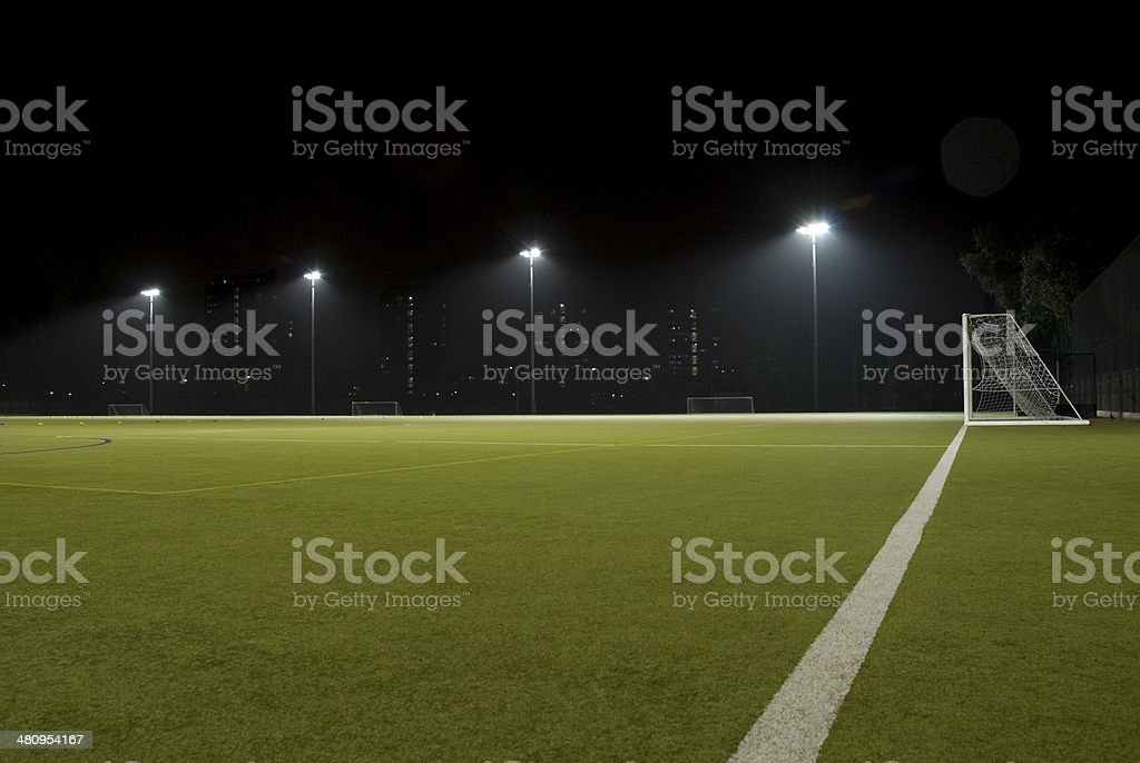 Floodlit astro turf football pitch stock photo