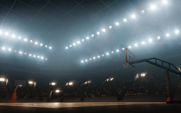 floodlit empty basketball court - basket foto e immagini stock