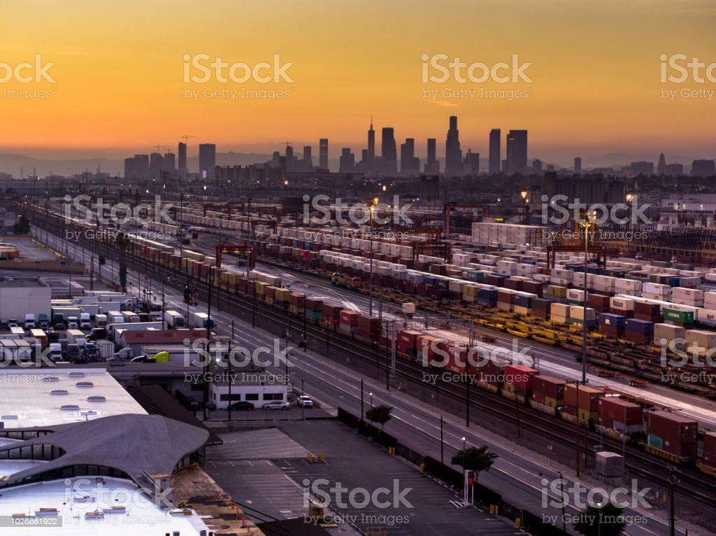 Floodlit Freight Train Yard in Vernon with Downtown LA Skyline at Sunset stock photo