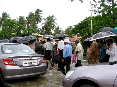 Mumbai, India - July 27, 2005: People and cars on the streets during floods in india in 2005 in Mumbai