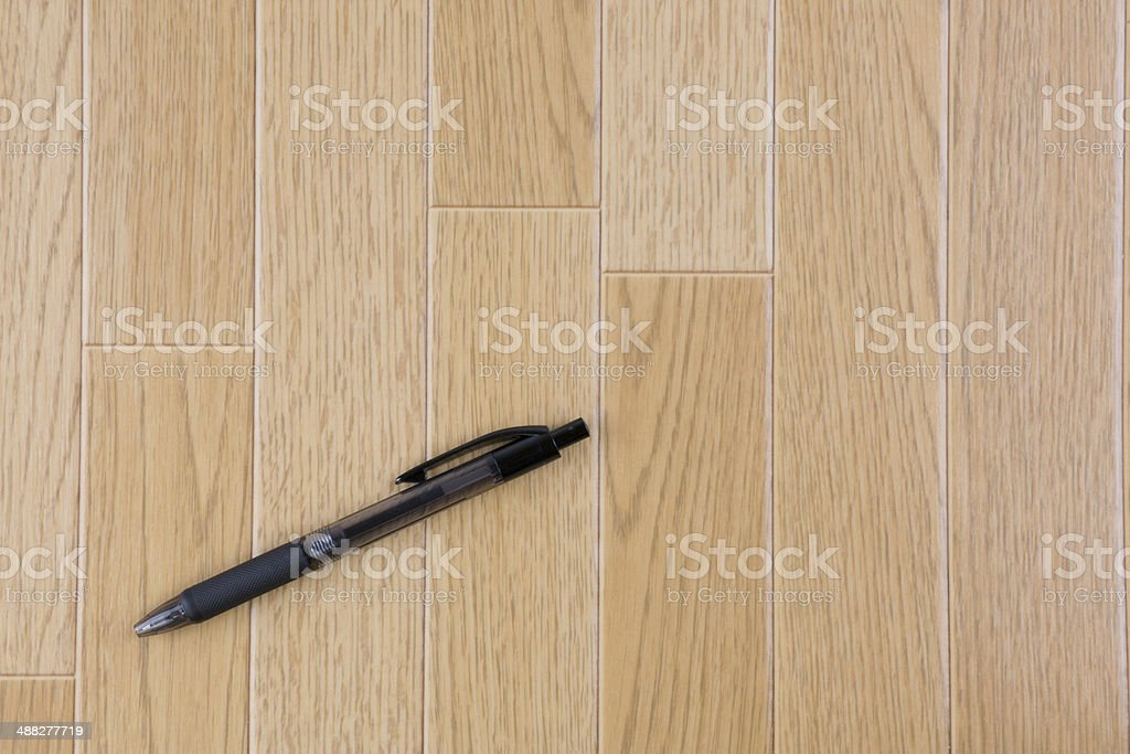 Floor and ball-point pen royalty-free stock photo