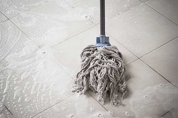 Floor cleaning Floor cleaning with mob and cleanser foam. mop stock pictures, royalty-free photos & images