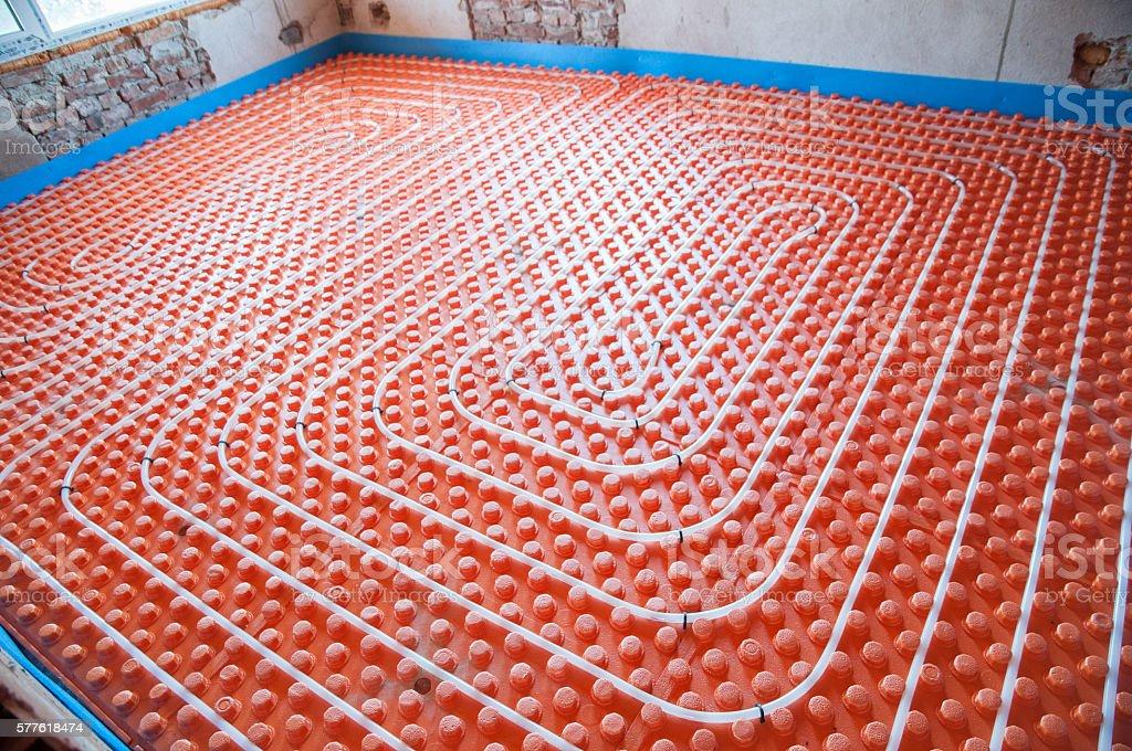 Floor heating installation stock photo