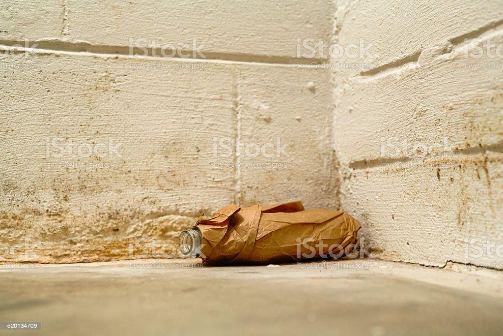 Floor level view of empty liquor bottle in brown bag stok fotoğrafı