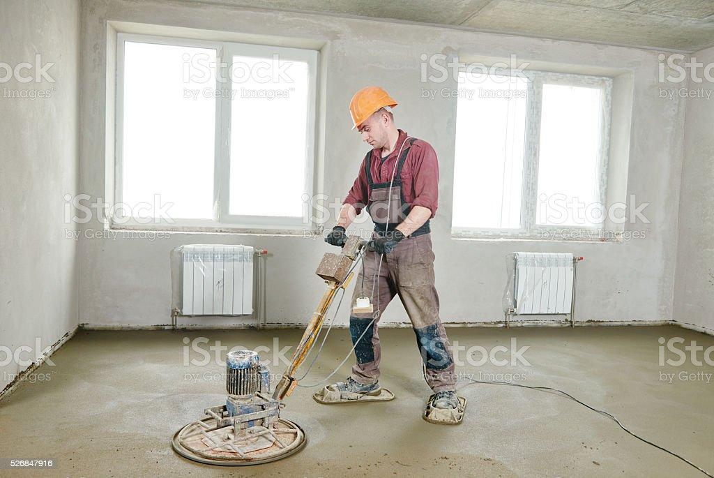 floor machine grinding by power trowel stock photo