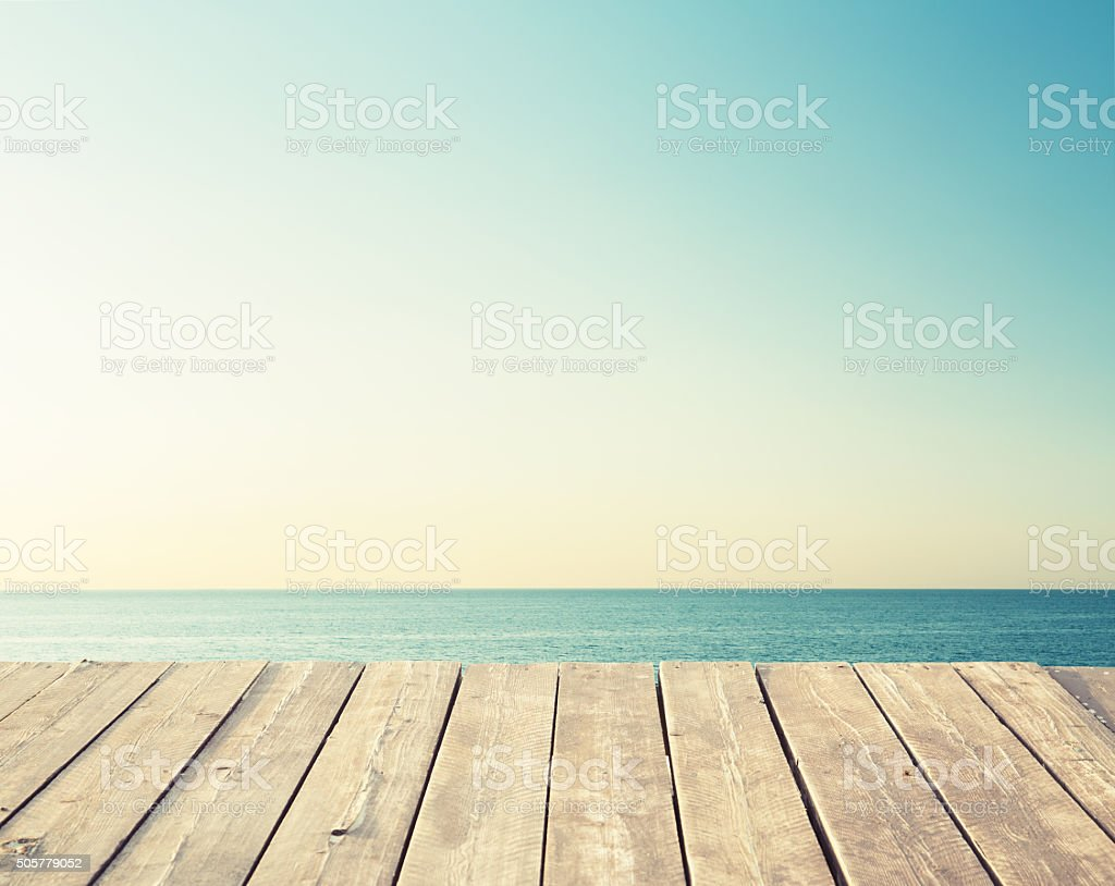 Floor made of wood planks on the sea background stock photo