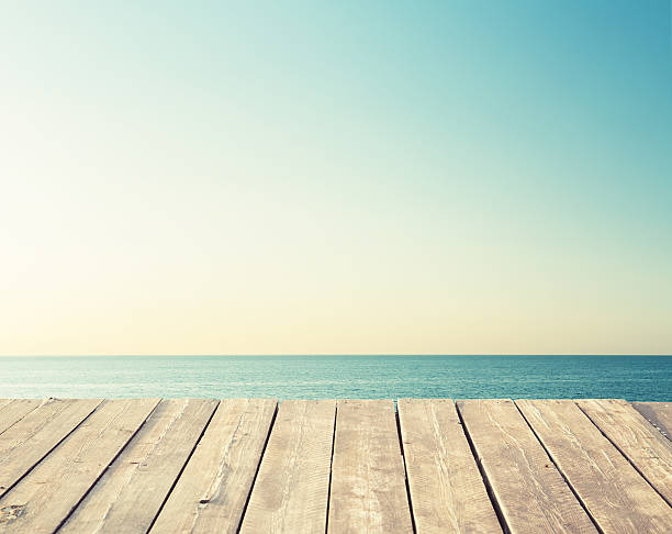 floor made of wood planks on the sea background - pier stock photos and pictures