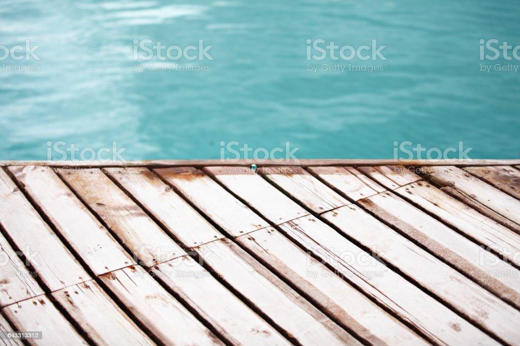 Los hechos de tablas de madera en el mar de fondo - foto de stock