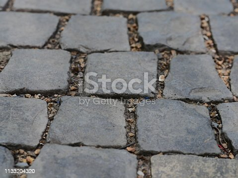 istock Floor Old cobblestone pavement 1133204320