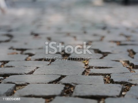 istock Floor Old cobblestone pavement 1133204383