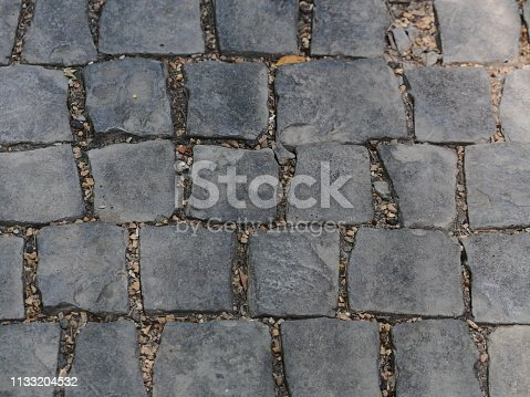 istock Floor Old cobblestone pavement 1133204532