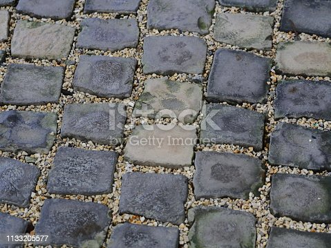 istock Floor Old cobblestone pavement 1133205577
