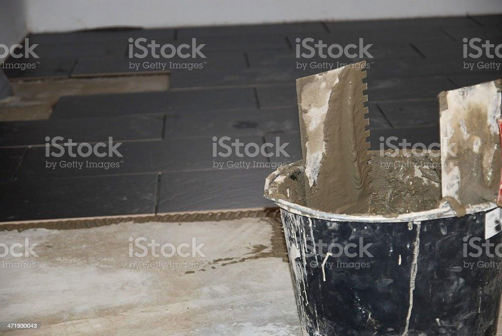floor tiler stock photo