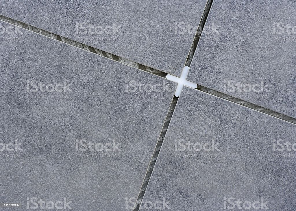 Floor Tiles and Tile Spacer stock photo